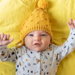 Newborn lifestyle fotograaf draagshoot borstvoeding baby fotoshoot Hilversum Lelystad